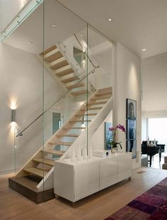 Floating stairs metal glass railing 34 Ideas Floating stairs me Stair Railing Ideas Floating floatingstairs Glass ideas Metal railing Stairs