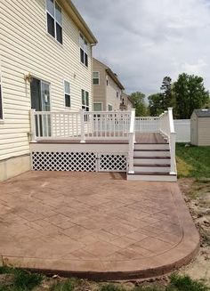 Custom deck and stamped concrete allvinylfencing.net
