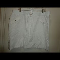 Nwt ny&co skirt size xl Solid white. New York & co street wear. Linen/cotton.machine washable. Not lined. Elastic waist.  Attached shoe string belt.  2 front faux pockets 2 back pockets. Approx 18.5 New York & Company Skirts