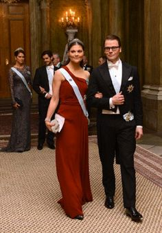 Swedish Crown Princess Victoria and her husband Prince Daniel arrive at the royal banquet for Nobel laureates at royal palace in Stockholm on 11 Dec 2012