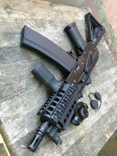 i would put one of those new forward grips on it that are at a 45 degree angle (to fit the natural position of the hand)