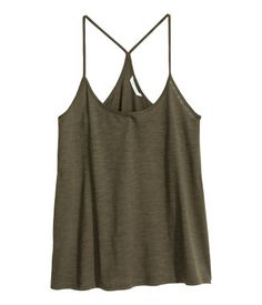 Wide-fitting top in slub jersey with narrow shoulder straps and a racer back.