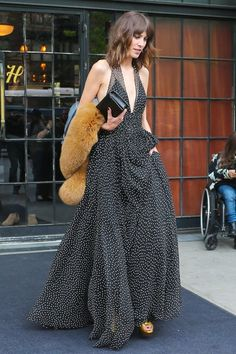 TV Presenter Alexa Chung was seen leaving the Bowery Hotel in the East Village of New York City. Alexa was looking stylish as usual in a polka dot dress and fur coat. Alexa added some pop to her black and white outfit with a pair of yellow heels.