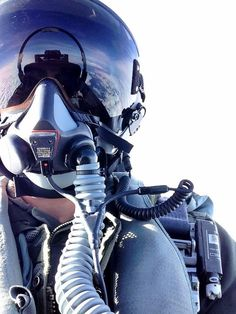 Fighter Pilot in cockpit doing what he does best.