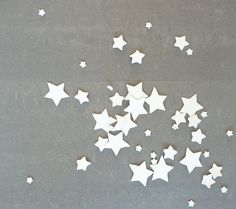 Porcelain stars - table decoration // MADE TO ORDER // For Christmas, a Wedding or Dinner party // Set of 45 // Free shipping worldwide. $45,00, via Etsy.