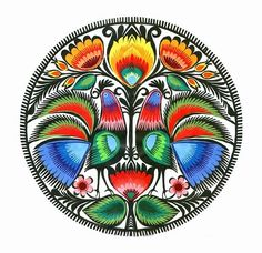 Wycinanki Art: I like the use of peacock feathers here and how the bend to the shape of the circle.