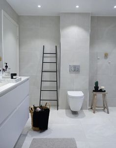 Symmetrically cut tiles over toilet. Concrete Tiles, White Concrete, 1920s Bathroom, Bathrooms, Bathroom Ideas, School Bathroom, Over Toilet, Terrazzo Flooring, Marimekko