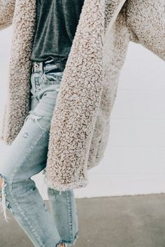 3dbb8529479 Winter fashion. Taupe faux fur and distressed jeans. Fluffy Sweater