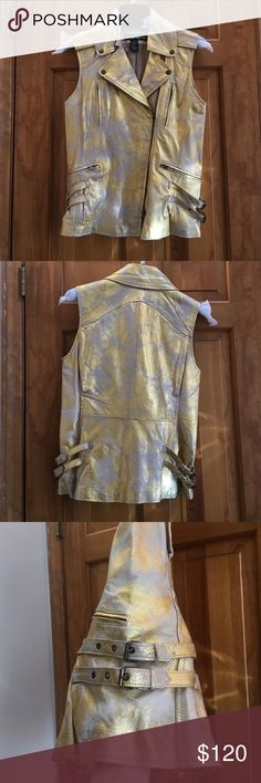 """Distressed metallic gold leather moto vest NEW Never worn and has been hanging in my closet. Has a tiny pin sized dark spots on the front -- not noticeable. Made of 100% leather. Cream and gold distressed color. Labeled XS but fits small better. 25"""" length, 16"""" bust. Price firm joseph israel Jackets & Coats Vests"""