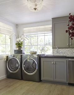 NV Design - laundry/mud rooms - Margeaux Ceiling Mount Chandelier, front load washer, front load dryer, laundry room beadboard <3