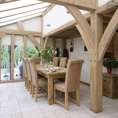 Oak framed conservatory with limestone floor, by Roderick James Architects