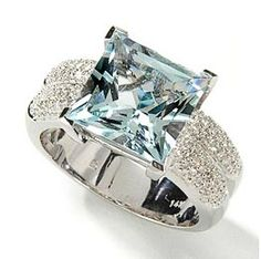 <3 not a big blue fan.. so I would choose a different center stone. but any way you look at it this ring it is FabuLous!!!!!