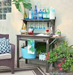 Inexpensive potting bench turned into an outdoor bar and beverage station for entertaining. The Creativity Exchange