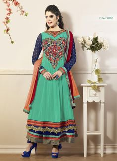 Be a bride glory in this popular turquoise faux georgette moti work anarkali suit . This suit is enhanced with cute patch work , embroidery and moti work adds allure elegance . comes with fancy matching bottom and dupatta.