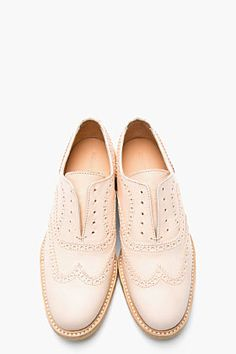 Love the look of these. WOMAN BY COMMON PROJECTS Blush Nappa Leather Laceless Wingtip Brogues
