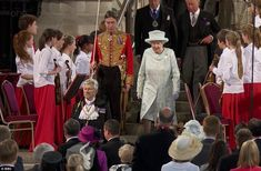 The Queen arrives for a banquet lunch at Westminster Hall to a grand fanfare of trumpets