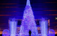 A FIBRE OPTIC CHRISTMAS TREE INSTALLED IN FRONT OF AN OFFICE BUILDING IN BEIJING.