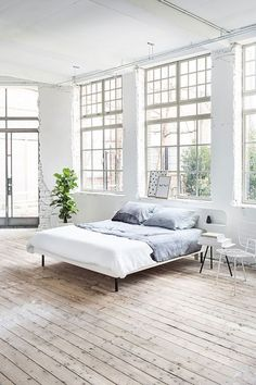 All white loft bedroom with minimalistic industrial design