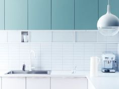 Kitchen with RUBRIK APPLÅD light turquoise doors, APPLÅD white doors and ÖSTHAMRA wall cabinets