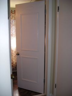 How to Faux panel a door...Update your flat paneled door with molding trim... - Jennifer Rizzo