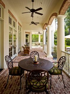 See the elegant, classic red brick flooring on this traditional front porch with ceiling fans and French doors on HGTV.com.