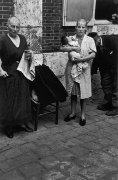 World War II, a French woman who conceived a baby with a German soldier, punished by having to have her head shaved as a form of humiliation for her treasonous act. Her mother also was subjected to the same punishment, June 1944.