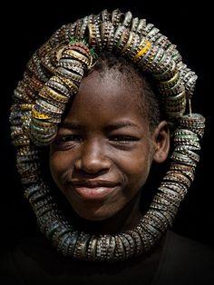 A Tsemai (Tsemay Tsamai) girl wearing a unique headdress made of bottle caps. Near the town of Weyto, Omo Valley ©Stefan Cruysberghs