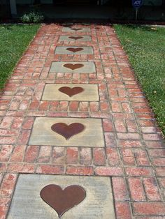 Stepping Stones and Path Combo to Update Your Landscape Create a brick walkway and then accent it with concrete stepping stones printed with heart shapes.Create a brick walkway and then accent it with concrete stepping stones printed with heart shapes. Brick Walkway, Brick Path, Brick Sidewalk, Concrete Walkway, Pathway Stone, Sidewalk Ideas, Brick Paving, Concrete Stepping Stones, Stepping Stones For Garden