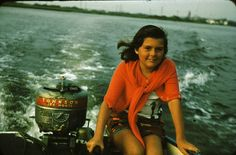 1950s photo: Linda driving the boat with the Johnson Sea Horse motor.