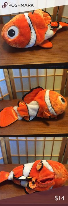 Disney Children's bag Disney Nemo has a 8' long zipper leading to a small storage area. There are some marks that can be worked out.  They are in two close up pictures and I can provide more if you want. Nose to tail he is about 17'. Bright Orange. Disney Accessories Bags