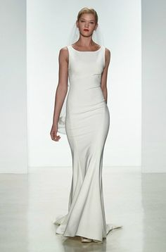 A minimalist, figure-flattering wedding gown. Perfect for the laid-back bride | Gown by Amsale