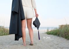 Senior Photography at the beach. Senior with cap and gown at the beach. More
