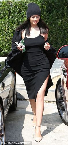 She's got the look! The 18-year-old paired the frock, which featured a thigh slit and spaghetti straps, with a loose-fitting cardigan