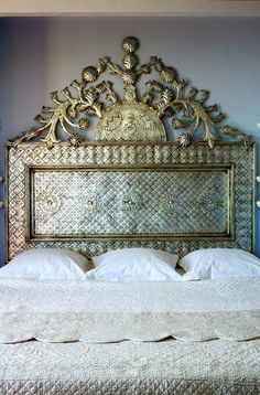 Fabulous metal headboard, with a striking patina, and that scallop edged quilt, ensures this space is a design winner!