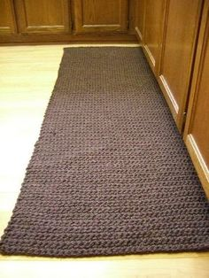 Crochet kitchen Rug  - Lion Brand Wool-Ease Thick And Quick Yarn -  7 balls of yarn and took about an hour per ball. Done in SC