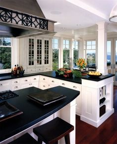 Love the clean look of black and white... and I'm so excited that they still used hard wood floors in a cherry tone... My fav!