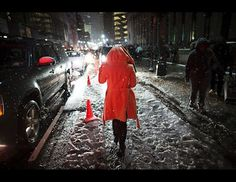 Snow falls on a pedestrian, Feb. 8, 2013, in New York. Snow began falling across the Northeast on Friday, ushering in what was predicted to be a huge, possibly historic blizzard and sending residents scurrying to stock up on food and gas up their cars.