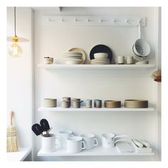 Shelves in our shop with ceramics from Kirstie van Noort, Hasami Porcelain, John Julian and enamelware from Riess