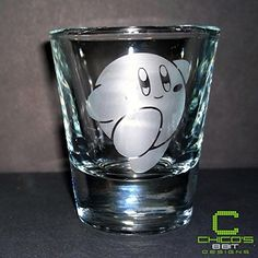 Kirby's Adventure - Kirby - Etched Shot Glass. This is a Kirby shot glass from the famous NES game Kirby's Adventure. It's somewhat of a throwback but who doesn't like some classic NES action? These are clear shot glasses etched on one side. They each can hold 1.5 oz and are very sturdy and built to last. All of these items are handmade, therefore, there might be slight differences from one item to the next. That being said, the quality of the product will not be hindered. Each shot glass...
