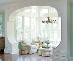 sunny room nook- beautiful windows, furniture arrangement.  I would love this space.