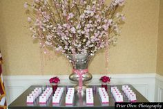 Cherry Blossom Bat Mitzvah Escort Card Table with Beautiful Arrangement {Party Planner: The Event of a Lifetime, Peter Oberc Photography} - mazelmoments.com