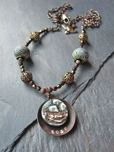 Love this necklace from Shannon Chomanczuk that features my nest charm and disk beads.