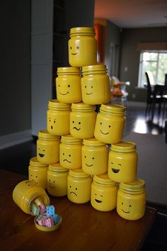 """Lego party goody """"bags"""" I just spray painted baby food jars and their lids with Sunshine Yellow. Then I used a Sharpie and drew on the Lego men faces. I filled them with Lego candy found in the bulk section of my grocery store. Lego Party Favors, Party Gifts, Party Bags, Boy Birthday, Birthday Parties, Diy Lego Birthday Party Ideas, Lego Friends Party, Lego Themed Party, Lego Parties"""