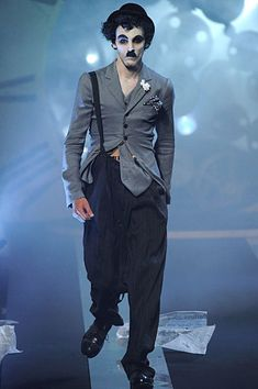 John Galliano cracks open the time machine for a theatrical collection inspired by Charlie Chaplin's Little Tramp. John Galliano, French Fashion, High Fashion, Paris Fashion, Dior, Dark Circus, The Fashionisto, John Charles, Charlie Chaplin