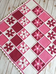 Crochet Daisy blanket made to order in shades of fondant, raspberry and white with a scalloped edging. Appliqué daisies give this a