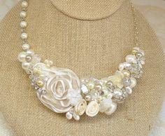Ivory Bridal Bib Necklace-Cream Wedding Statement Necklace- Rosette, Pearls, Lace, & Rhinestones- Floral Bib- Pearl Jewelry. $79.00, via Etsy.