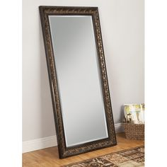 Martin Svensson Home Andorra L x W Brown Beveled Wall Mirror at Lowe's. The Andorra Leaner Mirror creates a warm atmosphere with large scale, elegant curves, ornate carving, and a touch of softness from the beveled glass. Art Deco Spiegel, Wood Interior Walls, Leaning Mirror, Contemporary Wall Mirrors, Dressing Mirror, Cool Mirrors, Framed Mirrors, Bathroom Mirrors, Mirror Mirror