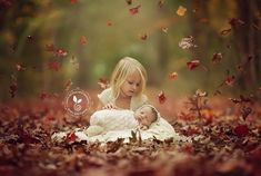 Gorgeous!!! Love the falling leaves weather it's a newborn photo or not!!!