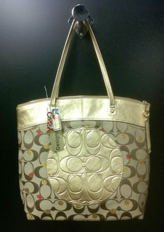 Coach gold tote at Clothes Mentor in North Richland Hills