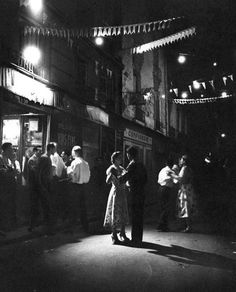 Couples dancing in the street in Paris, 1950s.